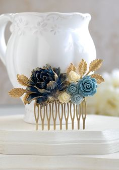 Dark Blue, Dusky Blue and Ivory Flowers Gold Leaf Bridal Hair Comb. I created this vintage style collage hair comb with gold brass leaves and high quality resin flowers in dark blue, dusky blue and ivory. The unique large dark blue rose has beautiful hand-painted gold tipped petals. All component are carefully and securely attached to a antique brass filigree hair comb. This hair comb is a prefect piece for a dark blue wedding would also make a great gift for a bridesmaid or someone special…