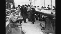 Winston Churchill visiting beardmores parkhead forge works to inspect the gun barrels being made for the war effort..
