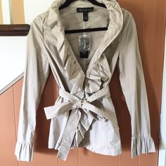 Beige Ruffled Top/Coat LOVE this nwt idk why I never wore it. So cute for fall or spring. Can be worn as a coat. The material is cotton with 3% spandex just like a shirt so it's your call how you want to wear this. Endless possibilities. Fits a size small. . NO TRADES EVER no low balls. Don't ask to trade I will say no even if I love your closet. Negotiable ONLY USE OFFER BUTTON INC International Concepts Jackets & Coats Blazers