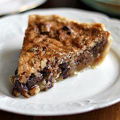 chocolate pecan bourbon pie with bourbon sauce