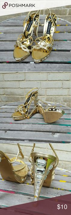 "Gold Bling Celeste Jeweled Heels Prom Perfect 7 Celeste gold metallic bling rhinestone platform heels. Missing one stone on back shown in photo. Worn once for a pageant . Comes in box. Size 7 1/2 . Runs true to size.  Heel is  4 1/2"".  #ravenkittystyle #platform #heels #metallic #gold #prom #homecoming #dance #size7 #71/2 #rhinestones #celeste #boutique #platform #fancy Celeste Shoes Heels"