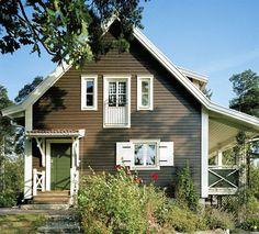 Brunsvart, vita knutar och grön dörr!