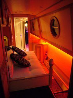Super modern lighting in narrowboat interior bedroom