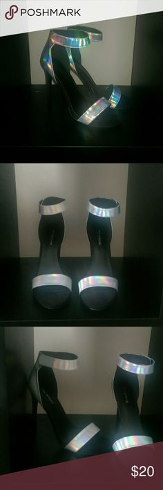 Strappy Stiletto Black and silver hologram reflector stiletto heels. Black part. is a fine suede-like material so it's a flat black. 4inch heel Call It Spring Shoes Sandals
