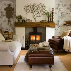 Love all the tree effects. Fireplace insert is totally spectacular! Not crazy bout the wall paper tho.