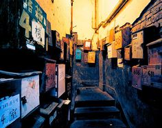 "Old Shanghai, Greg Girard. ""We see the mailboxes of homes meant for a single family, occupied by 20 tenants."""