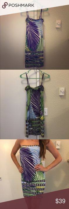 BCBG Strapless Multi-color Print Dress Multi-color strapless print dress, fitted around bottom band. Size XS, 93% rayon, 7% spandex. Shades of blue, green, purple, yellow. Great with wedges or heels for a summer night out! BCBGMaxAzria Dresses Mini
