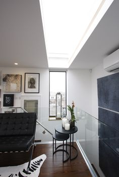 www.iqglassuk.com    Fixed picture window and corresponding frameless rooflight on roof extension in London