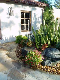 Rancho Santa Fe, Lilian Rice, courtyard, row home, field stone succulents, fount mediterranean exterior