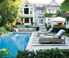 adore all of the different outdoor entertaining areas in this fabulous backyard, not to mention the inviting pool