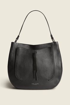 """A bag with bohemian flair, easy slouch and  spacious interior, the Maverick hobo is a smooth companion to carry. With contrasting suede details and raw edge construction, this shapely shoulder bag has style, space and a signature look.buDimensions/b/u13"""" L x 3 1/2"""" W x 11"""" H(33cm x 9cm x 28cm)buFeatures/b/u•Top handle•Topstitching with contrasting edge color•Exterior slip pocket with suede tassel•Interior zip pocket ..."""
