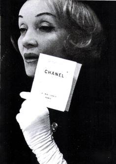 Marlene Dietrich arriving chez Coco Chanel for a fashion show, 1960 circa