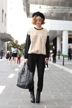 Notepads Out! 20 Next-Level Seoul Street-Style Snaps #refinery29  http://www.refinery29.com/2013/10/55989/seoul-korea-fashion#slide-7  What to do when your pockets are trompe l'oeil? Easy: Just grab a nice, slouchy tote to haul your stuff around in instead.