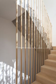 Timeless architecture and spaces Stairway with wooden slat railing. Casa Cinco Patios by Ana Rascovsky ARQS. Photo by Javier Agustin Rojas.