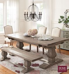 Simple neutral dining chairs allow for a patterned rug and stunning dining table to shine. These camel-back parsons dining chairs have a tailored look that doesn't distract from your dining table. And each is custom made so you can choose from 45+ fabrics to create your own. Not to mention, that nailhead trim! Pick an elegant chair to complement your dining table. Available at Home Decorators Collection.