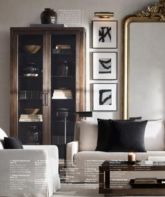 Masculine living room with a touch of glam.  Love the black and white artwork and gold mirror. Via Restoration Hardware Source Books