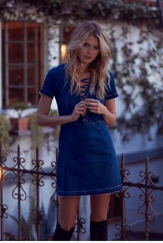 Dana Denim Dress | Super stretchy mini denim dress featuring a lattice lace-up detailing at the V bust.  Unfished and raw trim along the hem and sleeves.