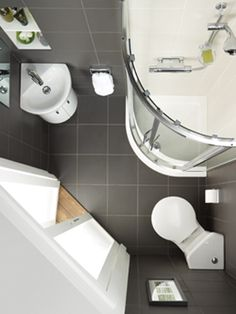 Design idea for a small bathroom featuring corner wash basin and corner toilet.