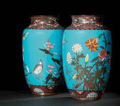 A PAIR OF CLOISONNÉ VASES  MEIJI PERIOD (LATE 19TH CENTURY)  Worked in copper, silver and gold wire and coloured enamels on a pale blue ground with birds and butterfly among tiger lilies and chrysanthemums between brocade designs, copper gilt mounts 24cm. high