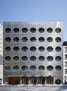 Dream Downtown Hotel chelsea ny #perforation #texture #architecture #circles #platinum #metall fasade