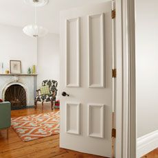 Apply panel molding to a featureless door to create a grand entrance to any room   Photo: Ryan Benyi