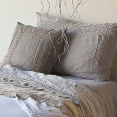 Bella Notte Linens: Homespun Coverlet in White, Homespun Bolster in White, Linen with Crochet Lace Sheets in Sand and Pebble, Linen Fitted Sheet in Pebble