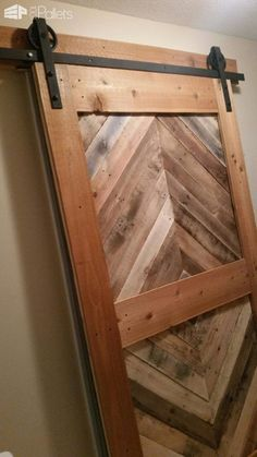 I made this Diamond Pattern Pallet Barn Door in three layers. The inside layer is x pine boards stained a carbon gray. I made the middle layer using pallet boards I cut in a diamond pattern. Then I belted it with more of the x pine. - November 10 2019 at Pallet Home Decor, Wooden Pallet Projects, Pallet Furniture, Kitchen Furniture, Kitchen Wood, Pallet Door, Pallet Barn, Pallet Walls, Pallet Bench