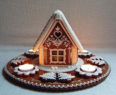 love the mini little house and the candles shining on it.