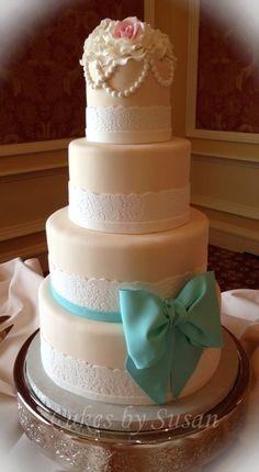 Blue bow vintage wedding cake