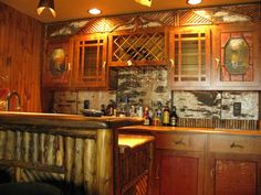 Look at the detail on this home bar! If it's not  from a lodge or cabin in the Adirondack/Great Camp/Molesworth style from the first half of the 20th century, it sure looks like it is. Spectacular.