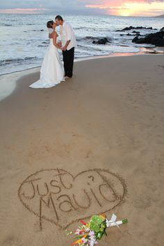 Cute pic idea...add the wedding date in the sand, too