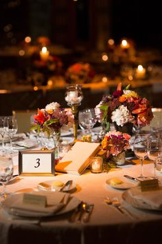 I love the neutral runner on bare farm table with low flowers and candlelight (though I don't love the bigger candles). I even like the napkin placement. From: Matthew Robbins Design Floral Wedding, Wedding Colors, Peninsula Chicago, Reception Decorations, Table Decorations, Big Candles, Wedding Pins, Wedding Ideas, Chicago Wedding