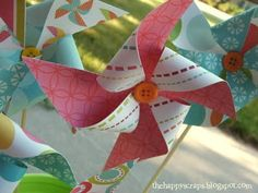 paper pinwheels. Love the buttons @Donna Thomas