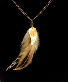 A personal favorite from my Etsy shop https://www.etsy.com/listing/247253898/natural-feather-and-mother-of-pearl-boho
