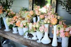 These white vases and garden flowers would be a beautiful centerpiece down the middle of a farmhouse table. I love the impact and statement made by a bunch of small bouquets.