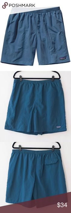 """Patagonia Men's Nylon Baggies Longs 7"""" Inseam Great, pre-owned condition. No flaws, plenty of life remaining! Size: XL. 7"""" Inseam.  Color: Glass Blue. Retail price: $49.  •Made of quick-drying SUPPLEX® nylon with a DWR (durable water repellent) finish •Elasticized waistband with internal drawstring; quick-drying black mesh liner •Vertical side pockets reduce drag in water; pocket bags have drain-and-dry mesh corners; rear snap pocket Patagonia Swim"""