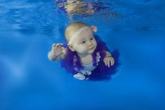 These adorable images are sure to spread holiday cheer. Infants learn underwater skills in a pool in Odessa, Ukraine.