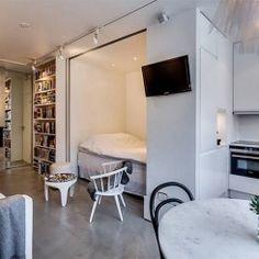 Apartamento pequeno para inspirar quem ama o cimento queimado
