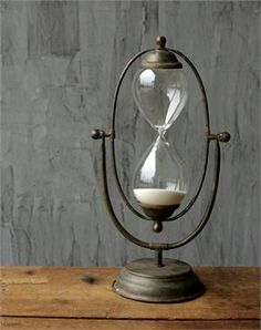 This 30 Minute Hourglass Sand Timer makes an elegant accent for a vintage style home office or kitchen. Inspired by nautical ship hourglasses, the aged metal frame adds a unique touch to this large timepiece. Time is approximately 30 minutes, but may vary.
