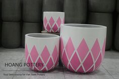 Hand Painted Cement set with Pink Lozenge patterns - A modern feminine touch to your space  . . . . . . #hoangpottery #vietnampottery #vietnam #vietnamese #pottery #cute #cutepot #cuteplanter #cuteflowerpot #modern #femininetouch #moderntouch #handpainted #handpainting #handpaintedpot #cementpot #cement #pink #pinkpattern #pinklozenge #lozenge #feminine #lozengepattern #pots #planters #flowerpots #style #trend #instyle #ontrend