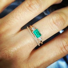 Emeralds and tiny diamond band. Beautiful!