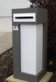 "Sandstone Letterboxes. The ""Medusa"" with white perspex"