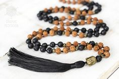 This mala necklace is made with natural rudraksha and black lava stones. Each bead is individually hand knotted. Malas are worn on the neck or left wrist while not in use. It may also serve as a nice accessory in everyday life or on some special occasions.  DETAILS: • Length: about