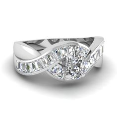 Stunning channel set straight baguettes embrace the center stone in an overlapping wave design on the #ring shank. This enchanting ring is centered by a shimmering #diamond shape.  http://jangmijewelry.com/