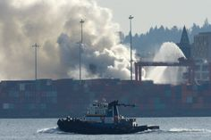 Smoke rises from a fire at the Port Metro #Vancouver in Vancouver on Wednesday, March 4, 2015. Residents of Vancouver's Downtown Eastside are being told to go inside their homes and close their windows after a chemical fire broke out in a shipping container at Port Metro Vancouver.