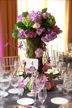 Woodland Wedding Inspiration. Rustic Centerpiece in Vibrant Orchid and Violet. >>Sally's Floral Design