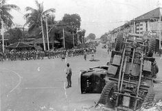 BRITISH PRISONERS-OF-WAR MARCHING ON THE ROAD TO CHANGI DURING JAPANESE OCCUPATION.  1942