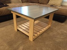 Weather gray coffee table with natural pine legs