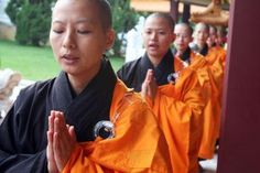 budhist nuns | buddhist nuns and monks pray during a service celebrating the 20th the ...