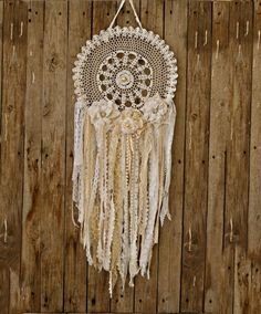 Boho dream catcher in white and beige. This dreamcathcher is made of handmade crochet doily and fabric flowers decorated with pearls and rhinestones. It's perfeect for shabby chic lovers. a romantic wedding decor. bridal shower decor, a baby shower.